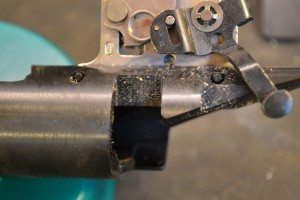 Note the location of both trigger pins. The front pin cannot be removed with the factory bolt stop in place.  The bolt stop, located on the other side of the trigger assembly blocks its removal.