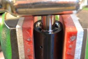 Next, we use the bushings to guide the receiver tap. This chases the threads and ensures they are square.