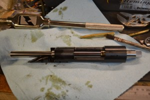 The receiver tap double as a mandrel to square the front face of the receiver on the lathe.  Mounting one end in the chuck and contacting the other with your live center would allow the lathe operator to true the front face.  We elected to go a different route.