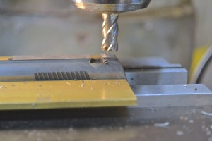 "The slide is secured in the mill vise and a 3/8"" carbide end mill is used to cut the top of the slide behind the pre-exsisting dovetail to the same depth as the factory dovetail cut."