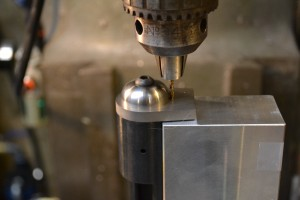 The entire fixture is secured in the mill's vise and the supplied cobalt drill is used to drill the hole to the proper depth.