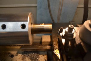 With the bore dialed in, we make a cut across the rear face of the barrel to ensure that it is perpendicular to the bore, then we begin to cut the tenon to length. We used high-speed steel (HSS) insert tooling from Brownells and Viper's Venom cutting oil. The combination of HSS tool and oil provides a smooth finish on stainless steel. The tenon will be initially cut to the diameter of the recoil lug.