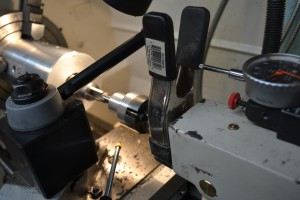 To measure the depth of cut, we attached a spring clamp to our tailstock and used a dial indicator in a magnetic base.