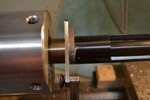 "Anti seize is applied to the barrel threads. The action and lug and threaded into place with the ""go"" gauge in the chamber. Once the action is tight against the gauge, feeler gauges are used to see how much deeper the chamber needs to be cut. The reamer stop is then adjusted to half of this depth and process repeated until the ""go"" gauge fits. When the ""go gauge fits, a ""no go"" gauge is then used to verify the chamber hasn't been cut too deep."