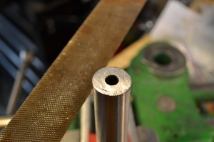 A large file is used to remove the saw marks.
