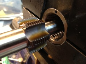 The receiver tap is used next. This cleans up the major diameter of the threads and provides a bearing surface to true the front face of the receiver.