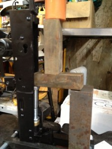 With the pin removed, this is the press configuration to remove the barrel. Note the pressur is being applied to the field expedient lever that was constructed using scrap steel.