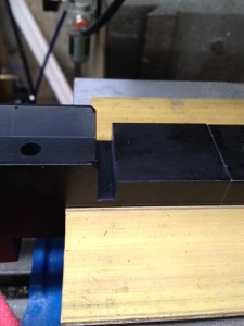The chassis is squared up in the milling machine vise.