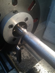 "A action, lug and bolt are screwed into placed with the .223 Remington ""go'"" gauge in place.  A feeler gauge is used to measure the remaining space along the tenon. The reamer stop is then retracted half of this dimension. and the process repeated until action can be screwed all the way in with the ""go"" gauge in place."