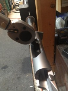 The barrel is secured in a barrel vise.  A Surgeon action wrench held in a torque wrench tightens the action into place.  Note: A small amount of anti seize is placed in the threads prior to final assembly to prevent galling of stainless steel parts.