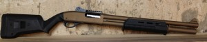 Here is our Burnt Bronze Remington 870 Police, now equipped with Vang Comp Systems ghost ring sights.