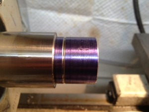 The barrel tenon is coated with layout fluid and then the end of the tenon is chamfered, a stop cut is made for the threads, and the inside corner of the tenon's shoulder is undercut so the recoil lug sits flush.