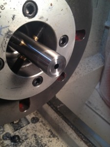 The barrel is cut to length and dialed-in in the lathe.  A boring bar is used to cut a recessed crown.