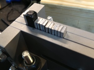 Using a guide we stamp the caliber into the side of the barrel.