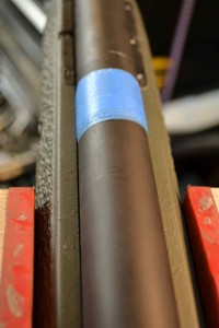 To begin, we wrap the barrel (behind the badger EFR) with tape to center it in the barrel channel.