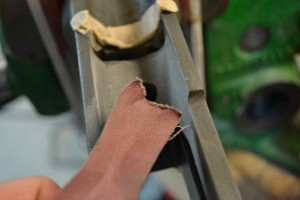 We use 120 grit abrasive cloth to remove paint from the surfaces which will be skim coated with epoxy.