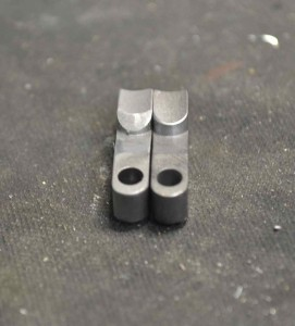 The rear of the bolt stop needs to be contoured with a file to allow the the bolt to be inserted without depressing it.  The contoured stop (left) is shown next to an unmodifed stop as supplied (right).