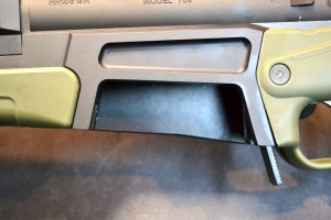 The left side of the magazine well has a large cut out to aide access.