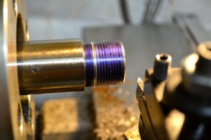 After a light pass, the pitch of the threads is checked.  In this case 16 threads per inch.