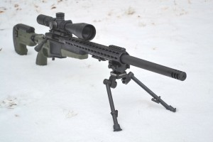 The JEC recoil reduction muzzle brake installed on the end of a customized Remington 700 chambered in 243 Winchester.