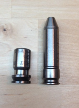 A belted magnum (left) go gauge compared to a rimless bottle neck cartridge go gauge (right). The belt magnum is headspaced with the rim, while the rimless cartridge is headspaced off a datum point on the shoulder. Most agree, headspacing off of the shoulder provides superior accuracy.