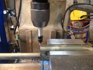 The receiver is secured in a milling machine vise.  The centerline and front edge are located.  This can be done using a drill press or hand drill if you don't have access to a mill.