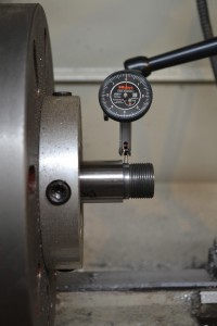 """The barrel is set up in the lathe.  I use a .0001"""" indicator to ensure that the barrel is aligned.  Failure to properly align the barrel with be problematic."""