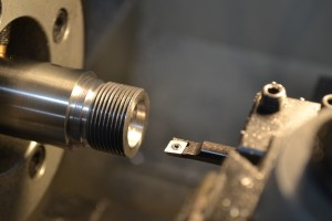 I use a high-speed steel insert boring bar to cut the bolt nose recess to the proper depth.  You can't use a piloted counter bore in this situation because the chamber has already been cut, the pilot has nothing to follow.