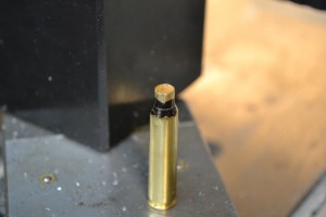 Here is a piece of unfired brass that that had its neck coated with marker.  Note the shiny area at the case neck and shoulder junction that holds the non fire formed cartridge.