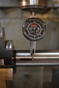 """Since the barrel has already been installed, I want to index the a """"rib"""" in between the flutes up. I use a .0001"""" indicator to determine the side of the barrel."""