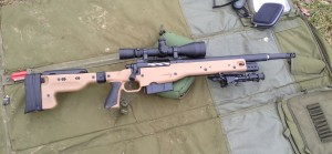 """A Remington 700, chambered in 300 Winchester Magnum with a 16.5"""" barrel and Surefire muzzle brake."""