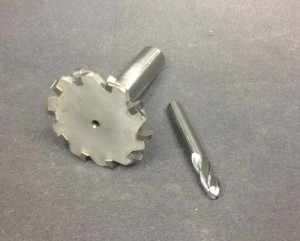 """A 3/16"""" PTG fluting cutter (left) and solid carbide ball-nosed endmill (right). Both will do the job, but the PTG cutter will cut faster and deeper."""
