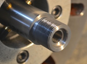 Before I remove the barrel from the lathe, I radius the outside edge of the bolt nose recess and break the edge of the chamber.  The radius on the bolt nose recess aids in feeding.  The radius on the chamber edge, prevents the cartridge case from scratching against a sharp edge.