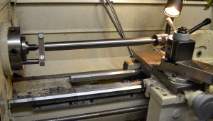 The barrel blank is then mounted between centers.  The barrel will be driven with a drive dog I made from scrap steel.