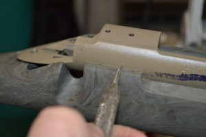 The action is placed in a stock and a line is scribed to indicate where the stock sits on the action.  Note: this is a left hand action in a right hand stock.  This does not matter for this mark.