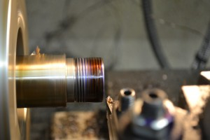 A sharp high-speed steel threading tool is used to cut the threads.  I am using Viper's Venom as a lubricant.