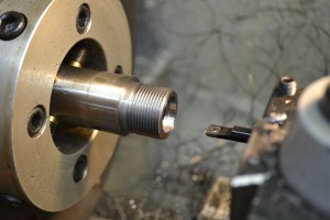 A high-speed steel boring bar is used to cut the bolt nose recess.
