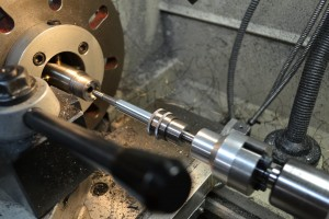 The reamer is secured in a floating reamer holder and is equipped with an adjustable reamer stop.