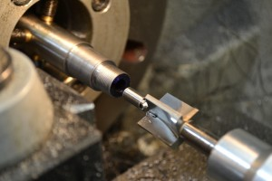 "A #3 piloted .420"" target crown tool is secured in a reamer holder to crown the muzzle."
