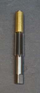 The choke threads are cut with this Manson choke tap.  It is guided by the same bushing used with the reamer.