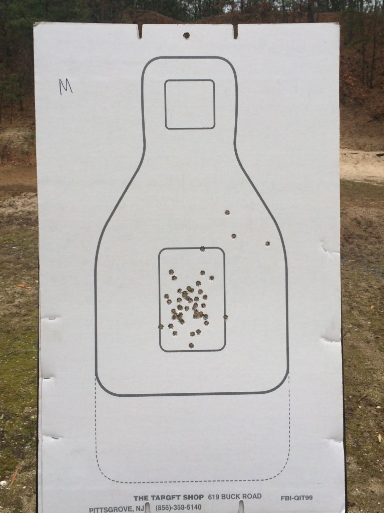 "My 15 yard target.  I dropped three rounds outside the ""x"" box but kept them in the scoring zone."