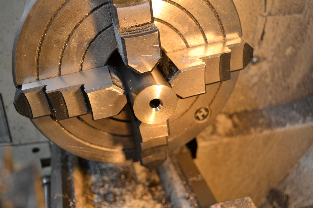 The end of the barrel after the center drill cut a relief.