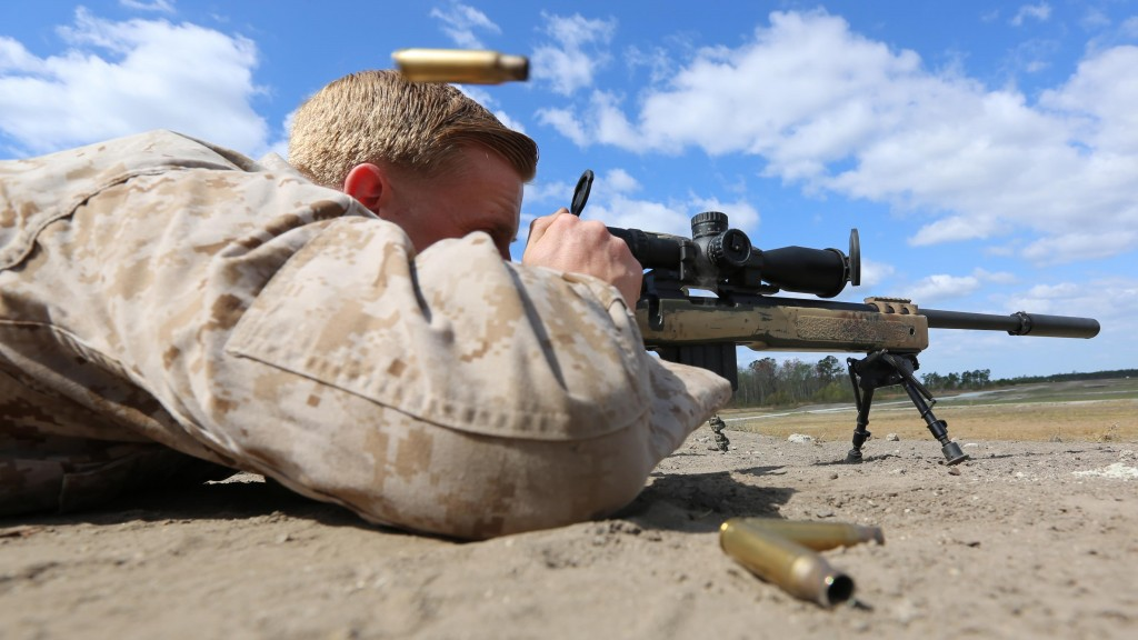 Marine Corps Base Camp Lejeune, North Carolina - Corporal Brandon Luke, a mortarman with Scout Sniper Platoon, 1st Battalion, 2nd Marine Regiment, fires an M40A5 Bolt-Action Sniper Rifle during an unknown distance range aboard Camp Lejeune, April 6, 2015. The platoon is currently working up to their deployment, which is slated to be a Unit Deployment Program to Okinawa, Japan.