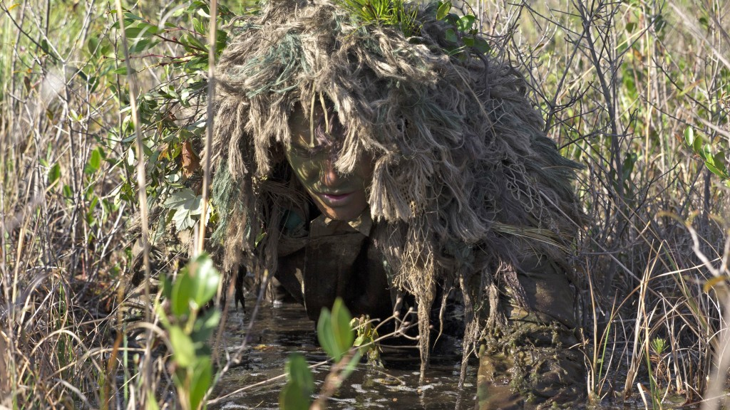 MARINE CORPS BASE CAMP LEJEUNE, North Carolina - Corporal Barton Harmon, a scout with Scout Sniper Platoon, Weapons Company, 2nd Battalion, 2nd Marine Regiment, crawls through a flooded field to get into a firing position during a stalking exercise in the vicinity of SR-10 aboard Marine Corps Base Camp Lejeune, North Carolina, April 22, 2015. The stalking exercise was one of many conducted by Marines attending the Scout Sniper Basic Preparation Course over the course of two weeks.