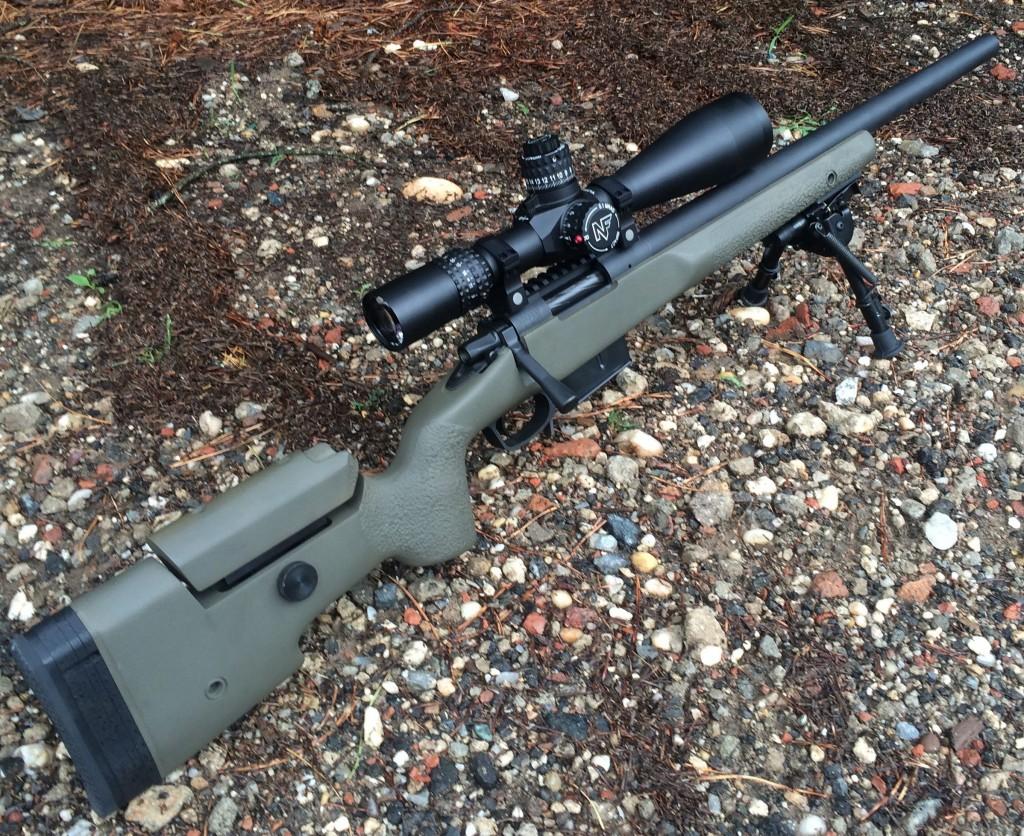 6.5 creedmoor custom rifle on gravel 2